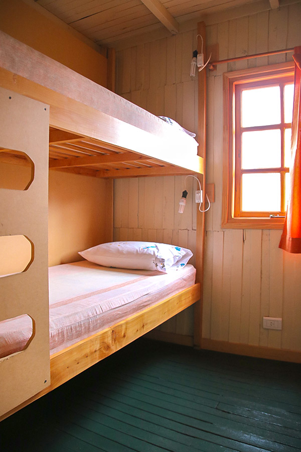 Bunk beds in Estancia Las Hijas on day 12 of Guided Full Patagonia Adventure Tour in Patagonia