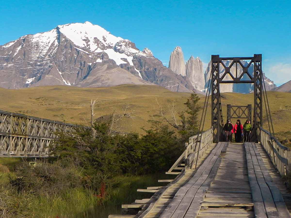 Crossing the bridge over River Paine on day 11 of Los Glaciares and Paine Adventure trek with group