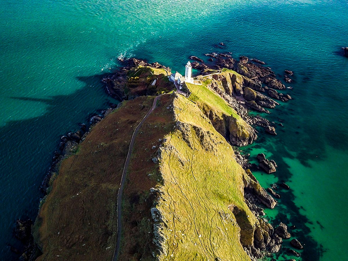 Aerial view of the Star Point Lighthouse that you get to pass while on South Devon Coast Trekking Tour