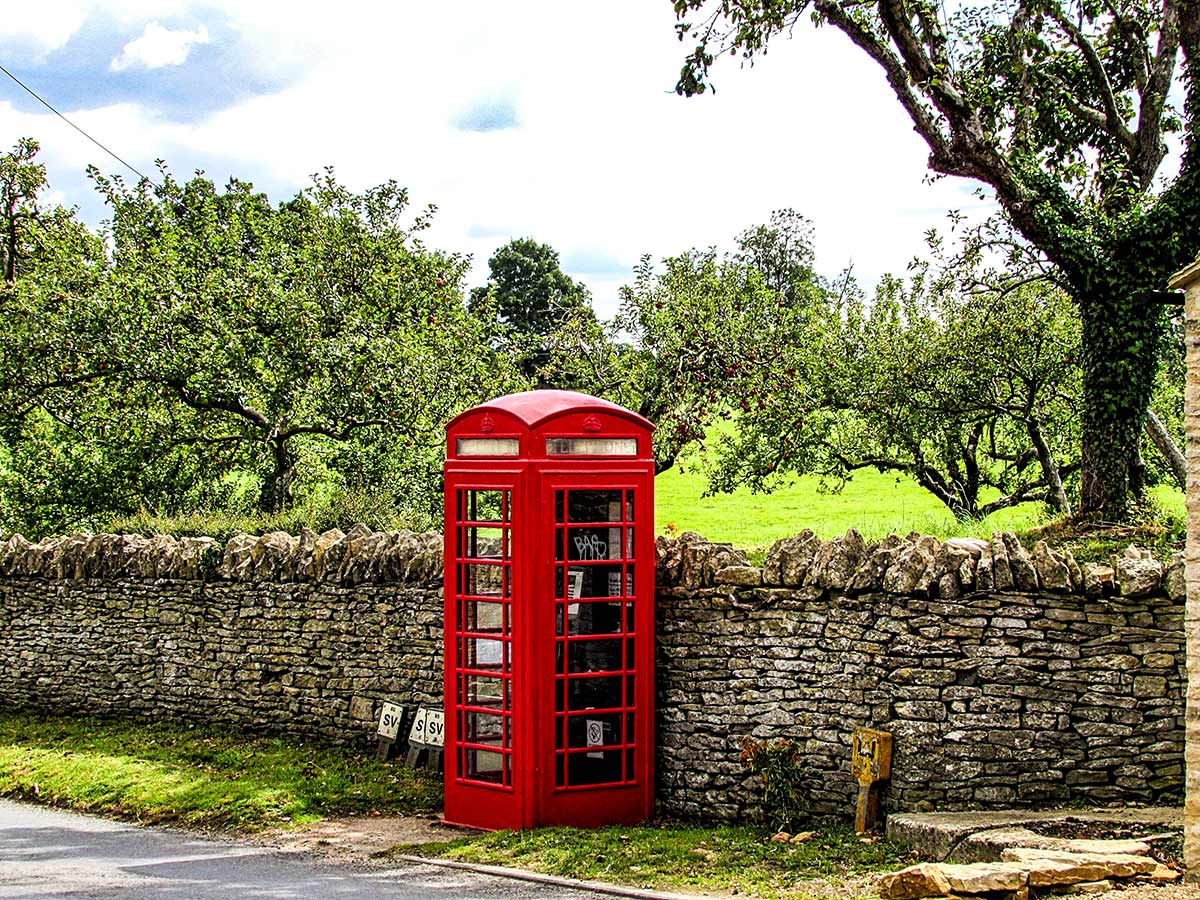 Red phone booth seen near Bibury on Stratford to Bath Cycling Tour