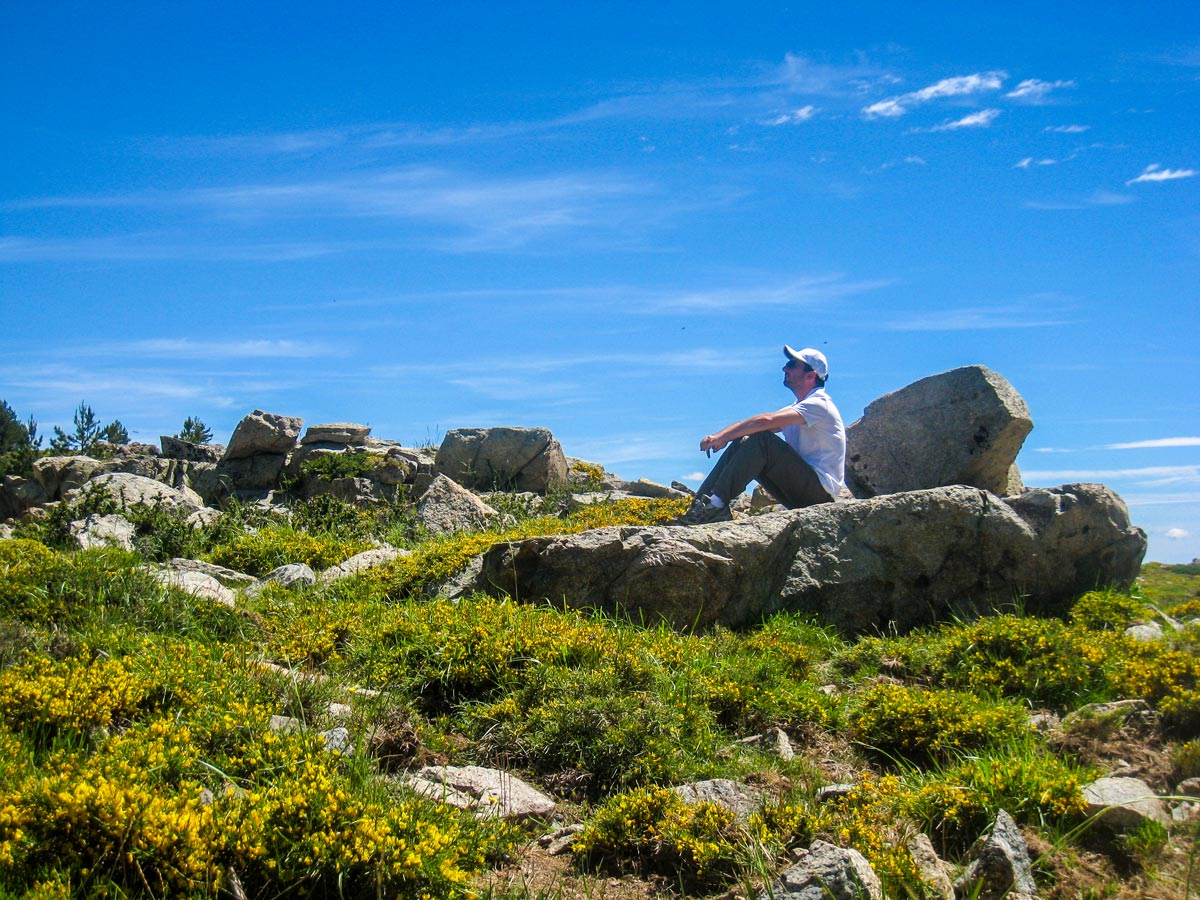 Hiker resting near the rock on Donkey Tour in Niolo Corsica