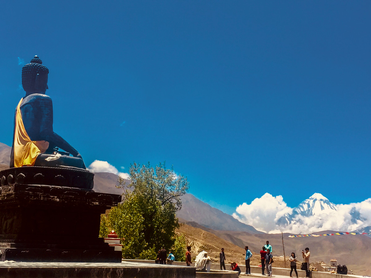 Big statue of Buddha on Annapurna Cycling tour in Nepal