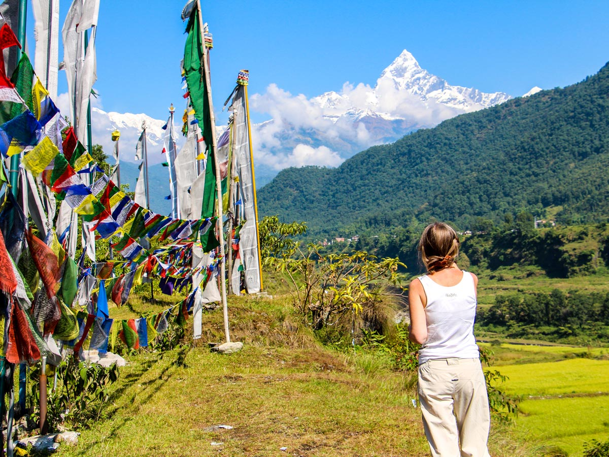 Looking at Machhapuchhre mountain on Family Adventure Tour in Nepal