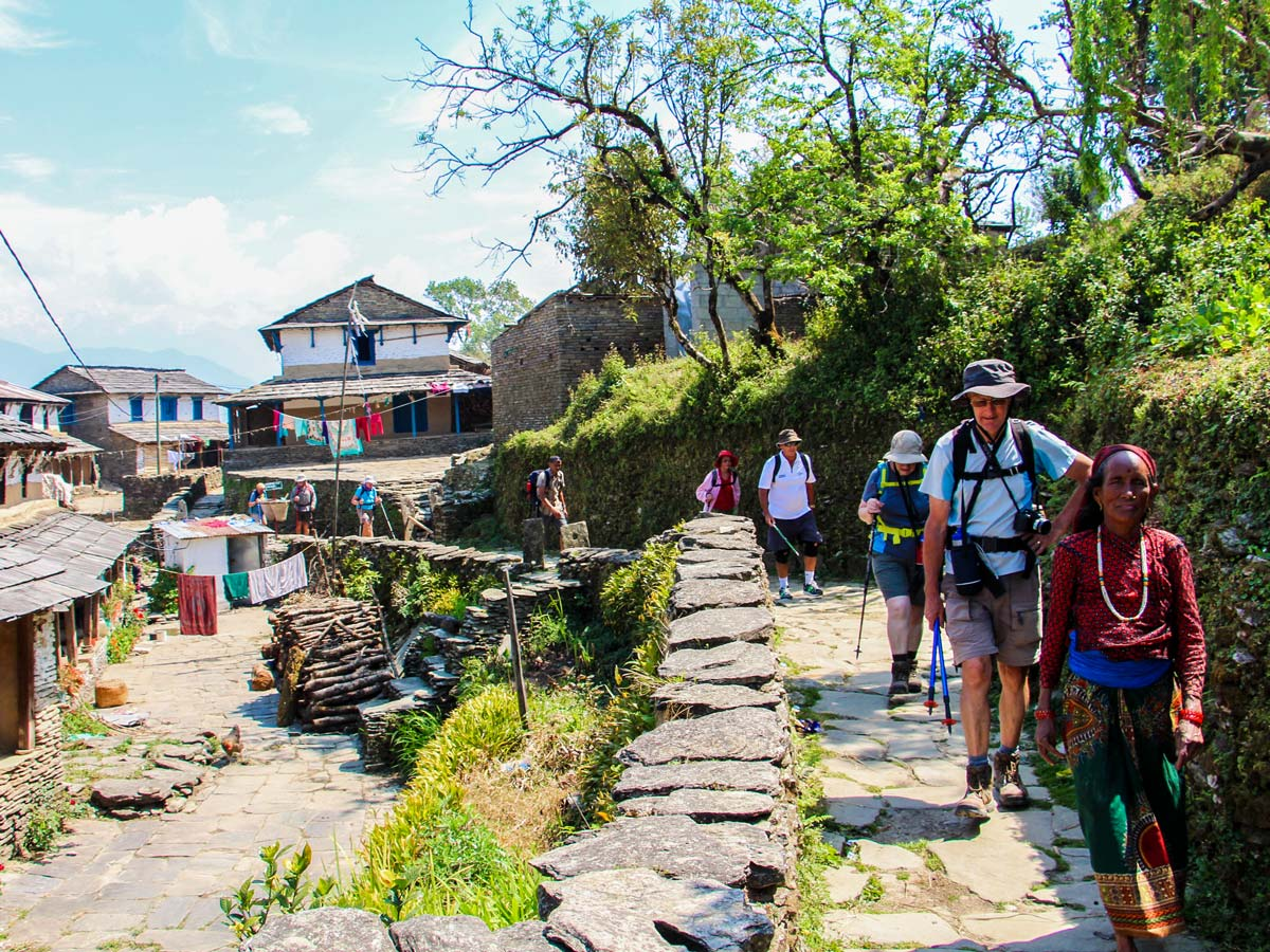 Hiking in Himalayan village on Family Adventure Tour in Nepal