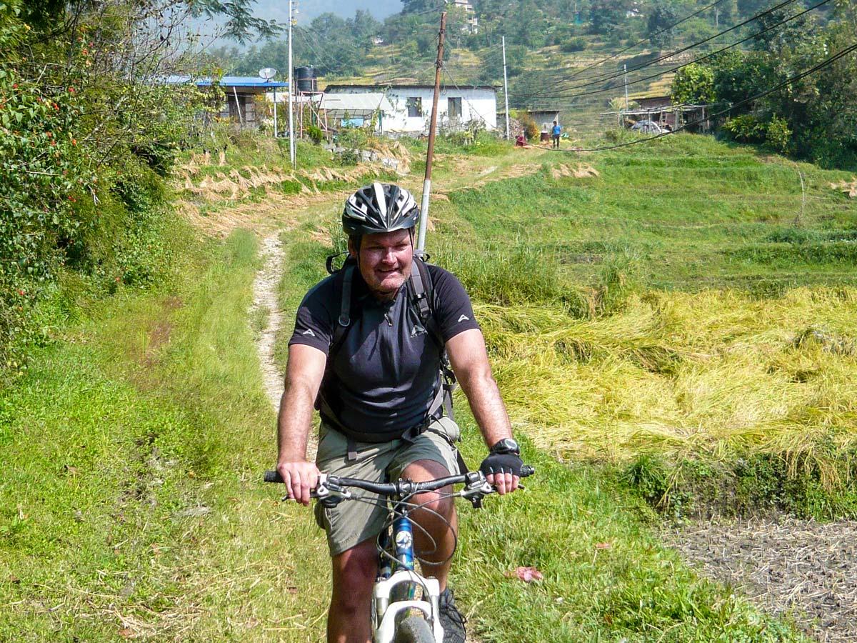 Happy biker on Biking around Kathmandu Tour in Nepal