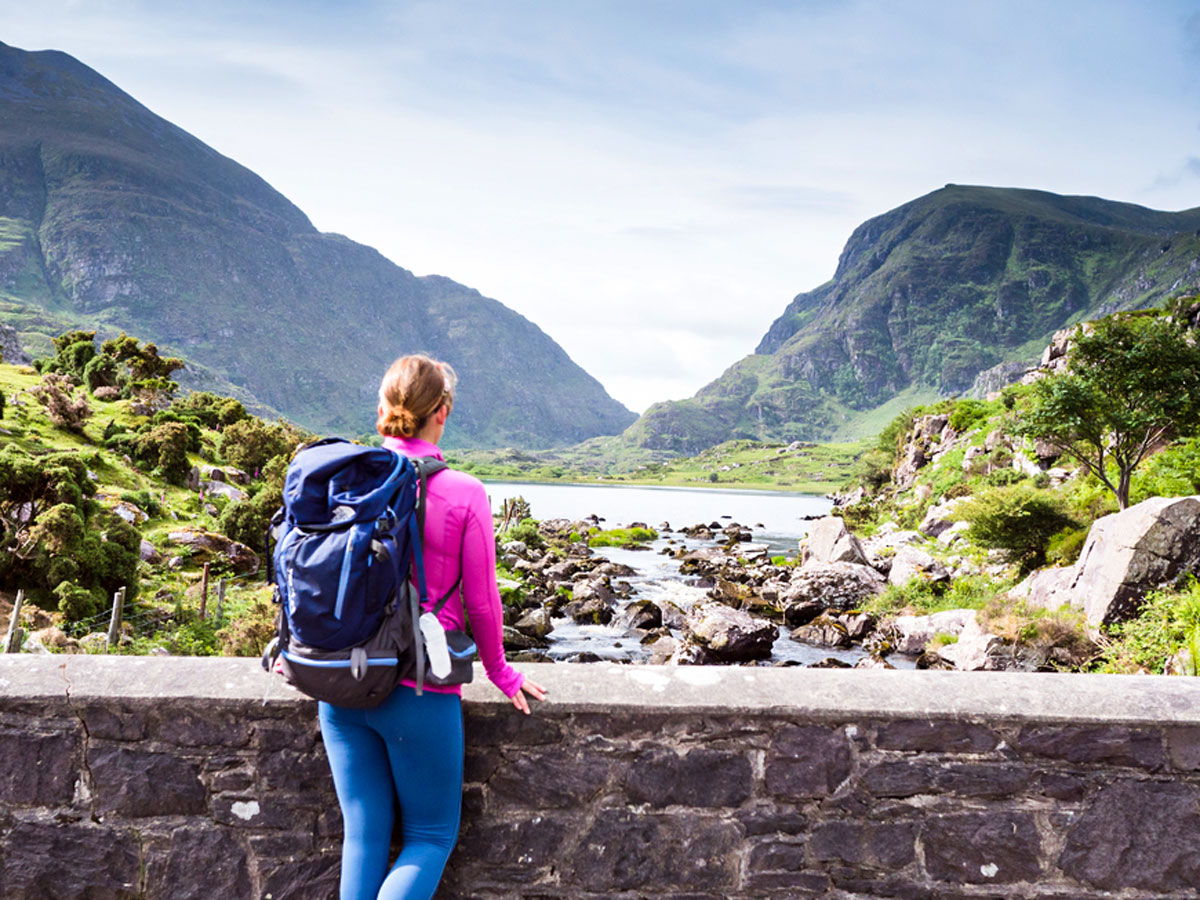 Crossing the Wishing Bridge while on Deluxe Hiking Kerry Mountains tour
