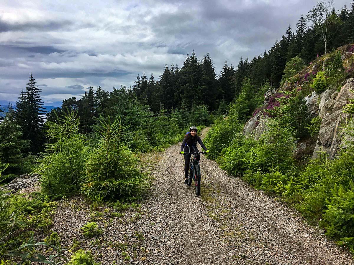Biker on a gravel road on Mountain Biking across Scotland tour