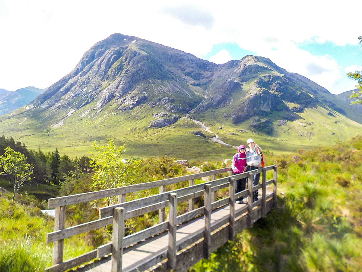 Crossing the bridge on Glencoe and the Highlands trekking tour in Scotland