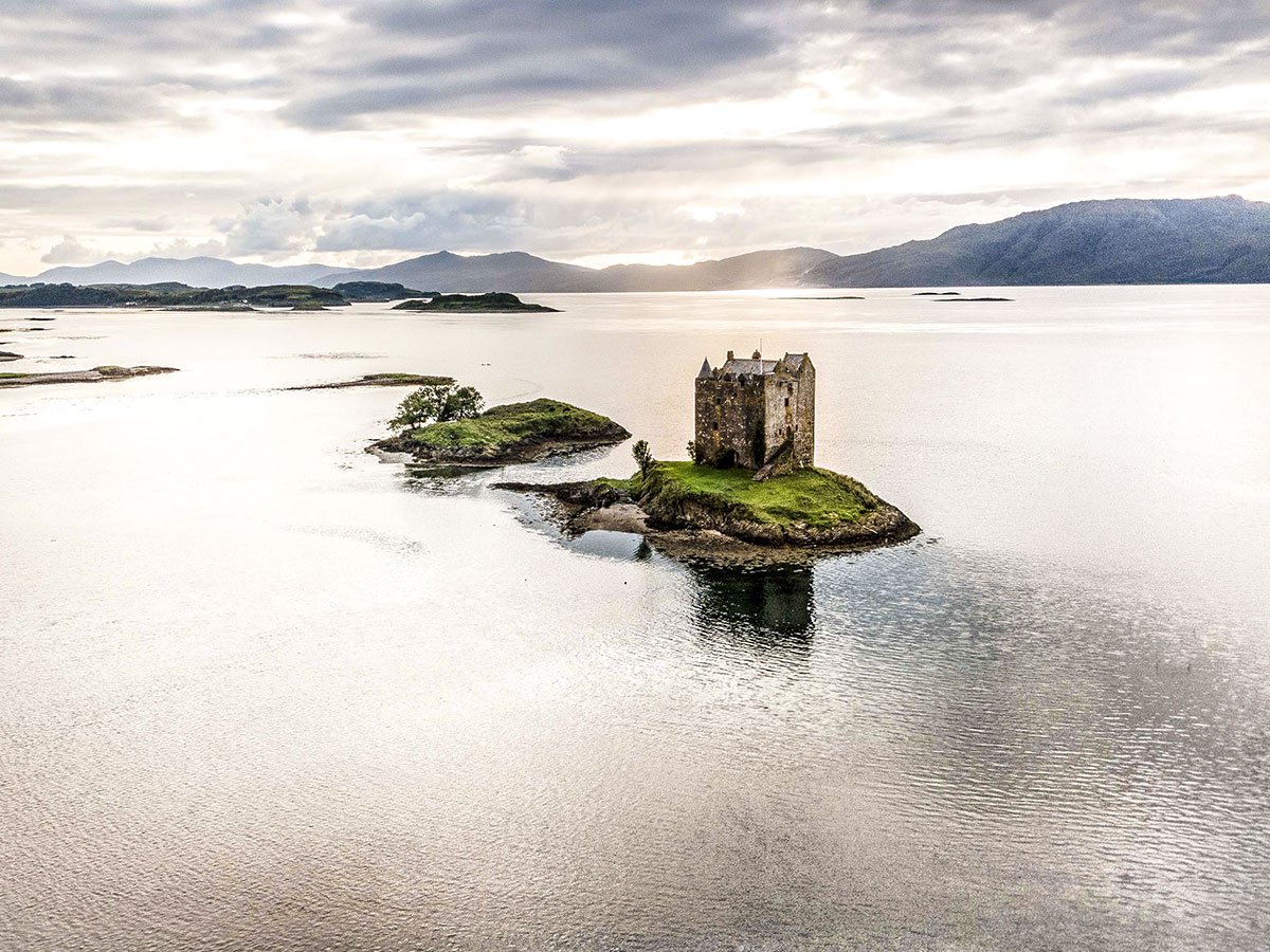 Aerial views of the castle on Loch Laich that can be seen on Glencoe and the Highlands trekking tour in Scotland