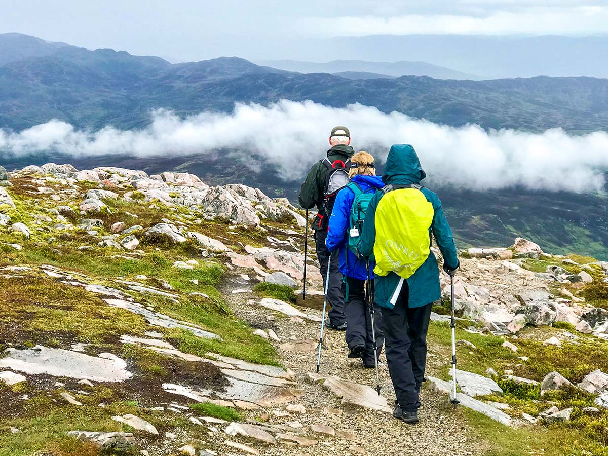 Group of walkers trekking on guided Glencoe and the Highlands walking tour in Scotland