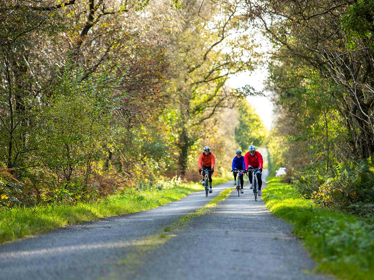 Two cyclists biking on the beauitful road on Road Cycling tour from Inverness to Edinburgh