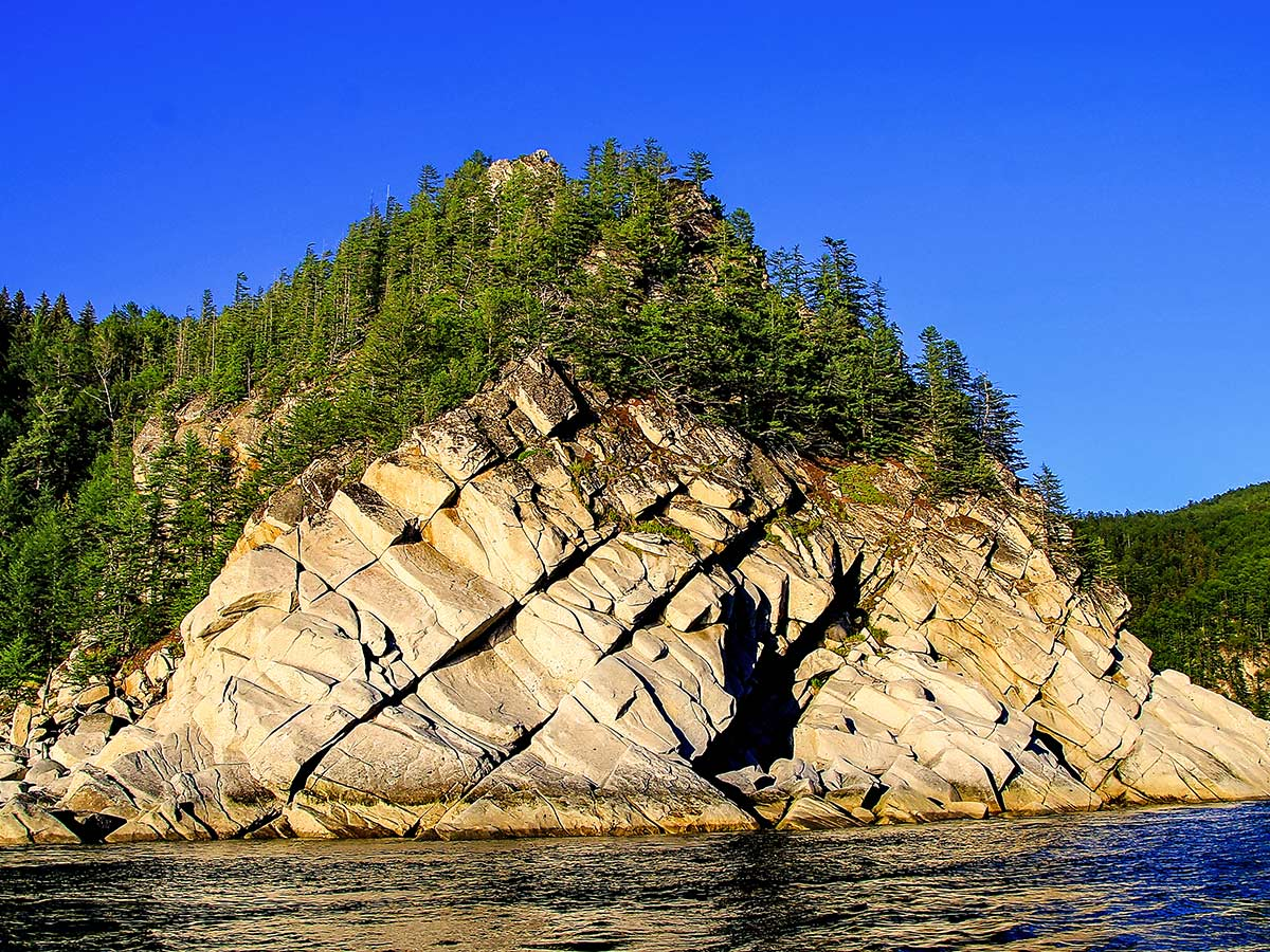 Shantar islands have rocky shores that can be seen on Expedition to Shantar Islands Tour in Russia
