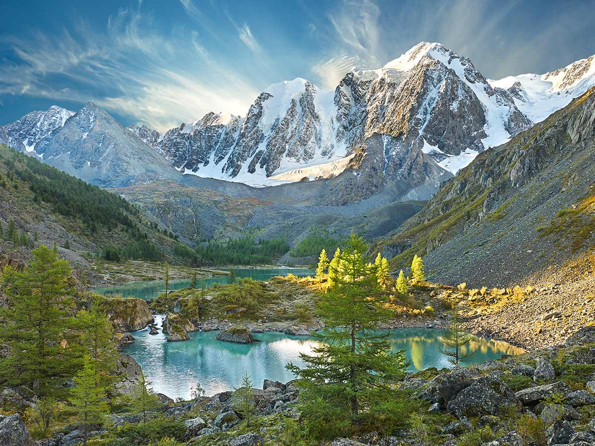 Two turqoise lakes under the snowy peaks of Altai Mountains