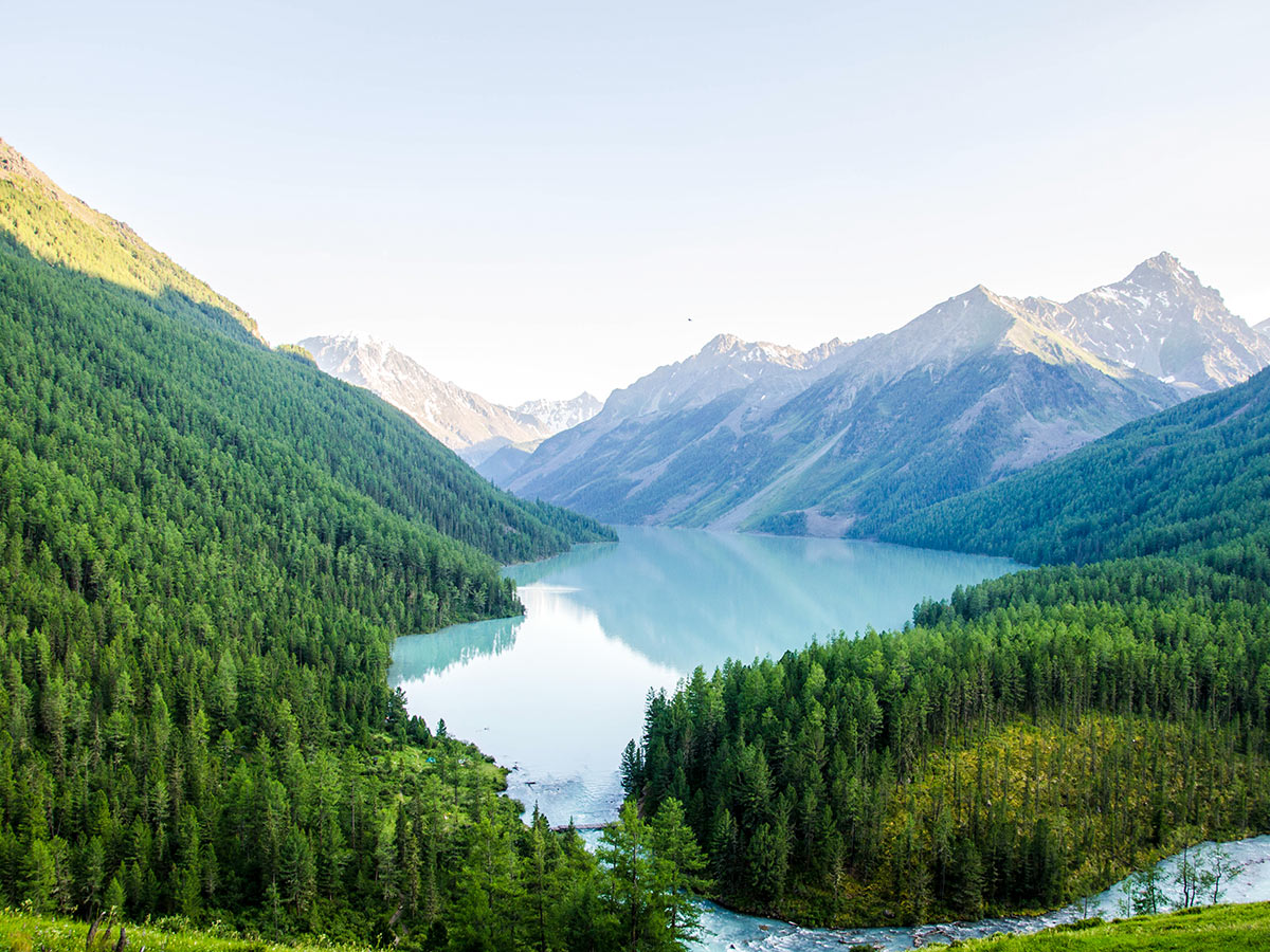 River flowing into the blue lake surrounded by Altai Mountains in Russia