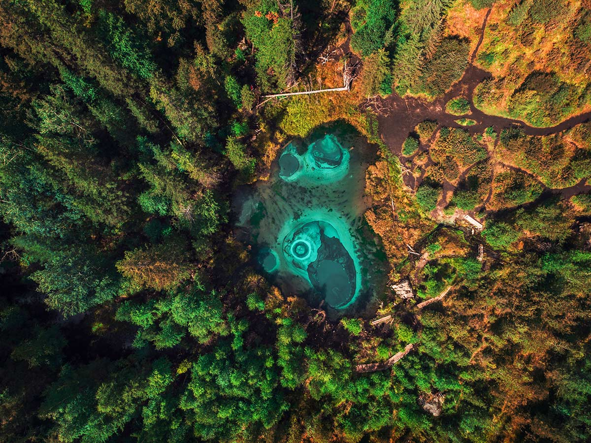 Aerial view of turquoise ponds seen on Golden Ring of Altai Tour in Russia