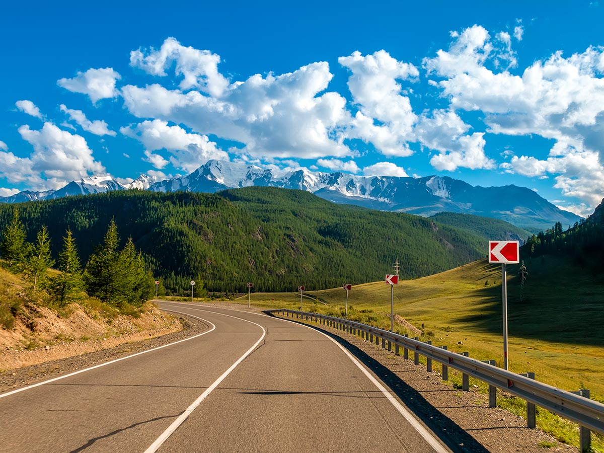 Wide road in Altai Mountains seen on Golden Ring of Altai Tour with a guide