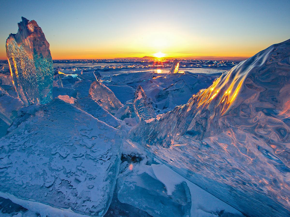 Sunset behind the ice formations on Lake Baikal