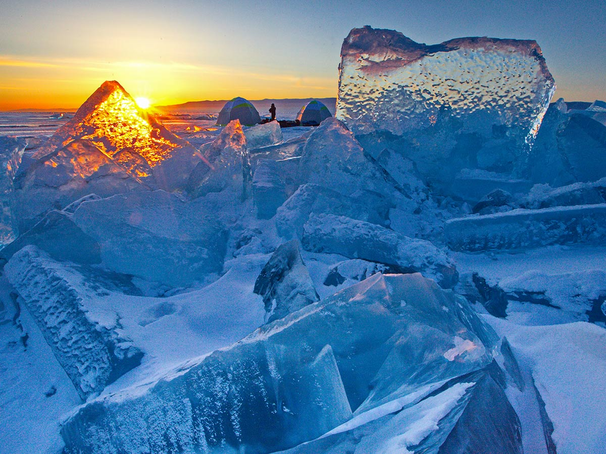 Ice formations on Lake Baikal covering sun that is setting