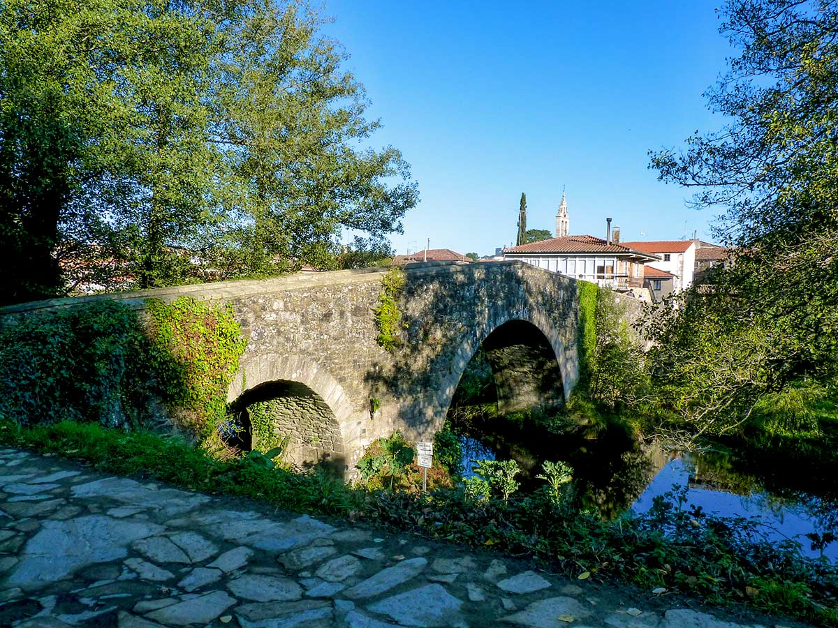 Crossing the Rio Furelos in Melide on French Camino Biking Tour