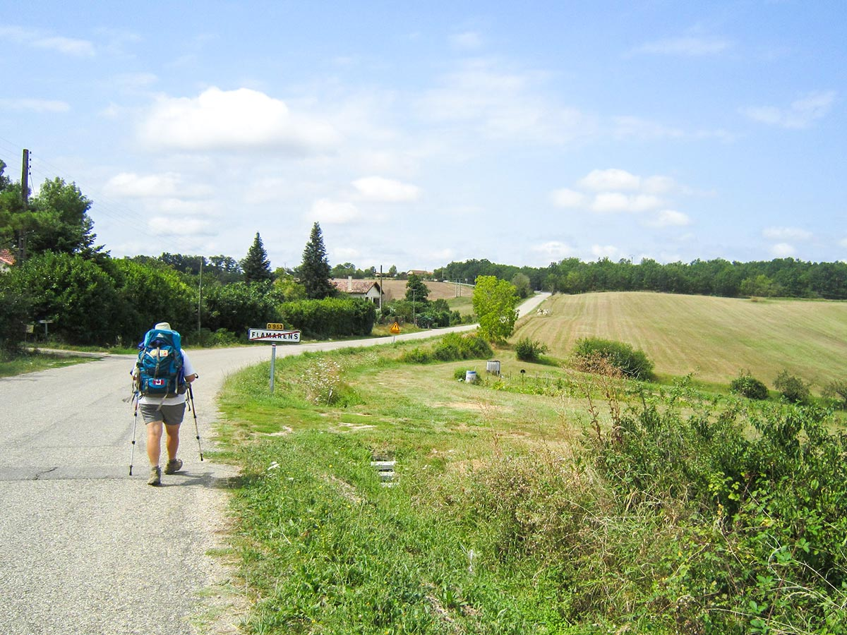 Passing the hikers on Camino de Santiago French Way biking tour