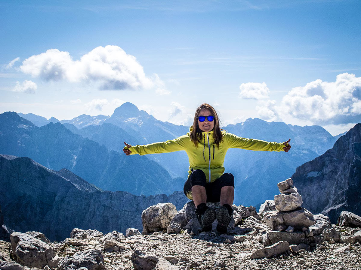 Happy hiker posing on the mountian on Discover Slovenian Alps Tour