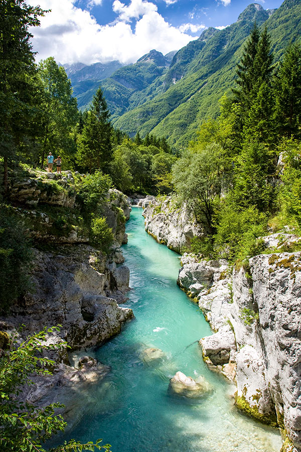 Blue creek surrounded by Slovenian Mountains