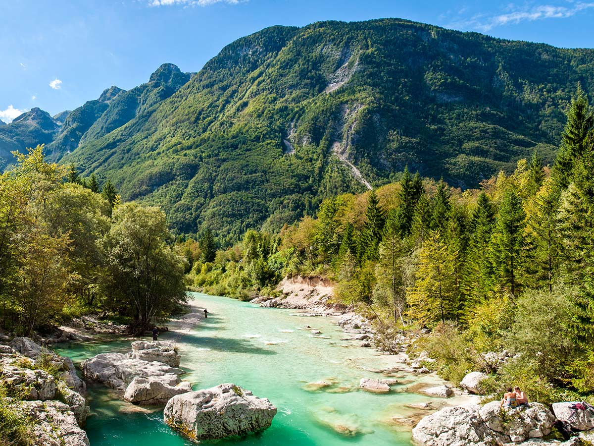 Turquoise creek in Soca Valley Slovenian Alps
