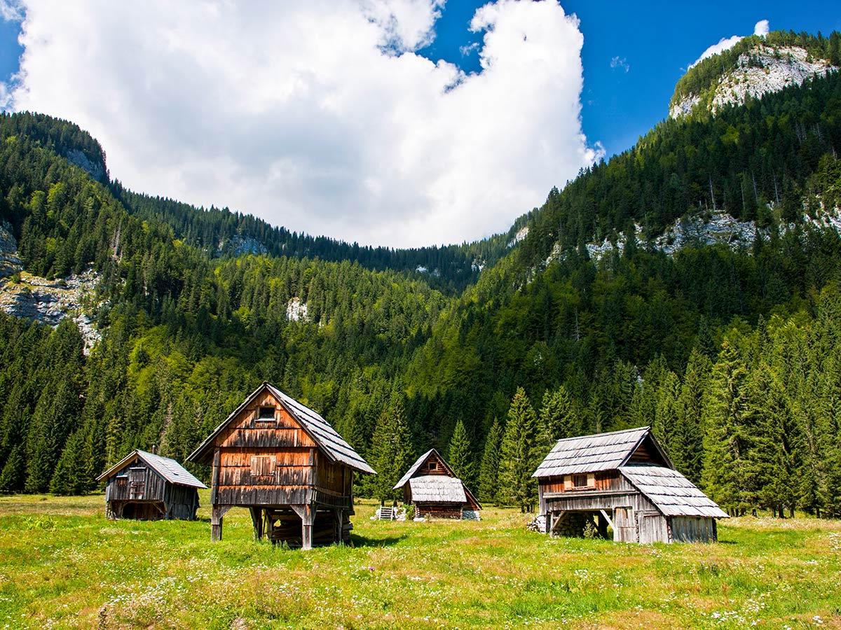 Farmhouses under the Slovenian Mountains seen on Hiking in Slovenian Alps on Hut to Hut trek