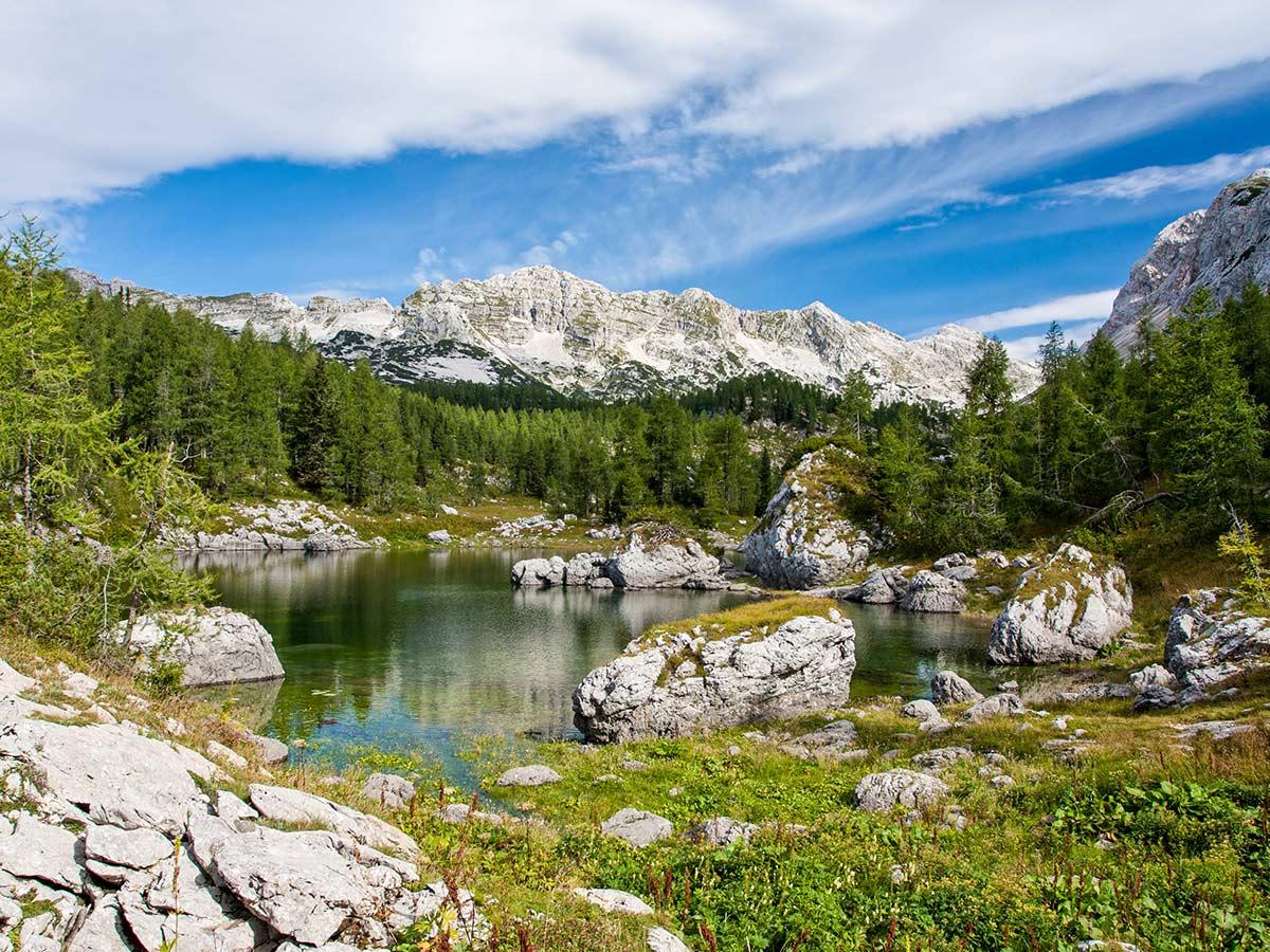 Beautiful tarn in Triglav National Park along the trail of Hiking in Slovenian Alps on Hut to Hut trek