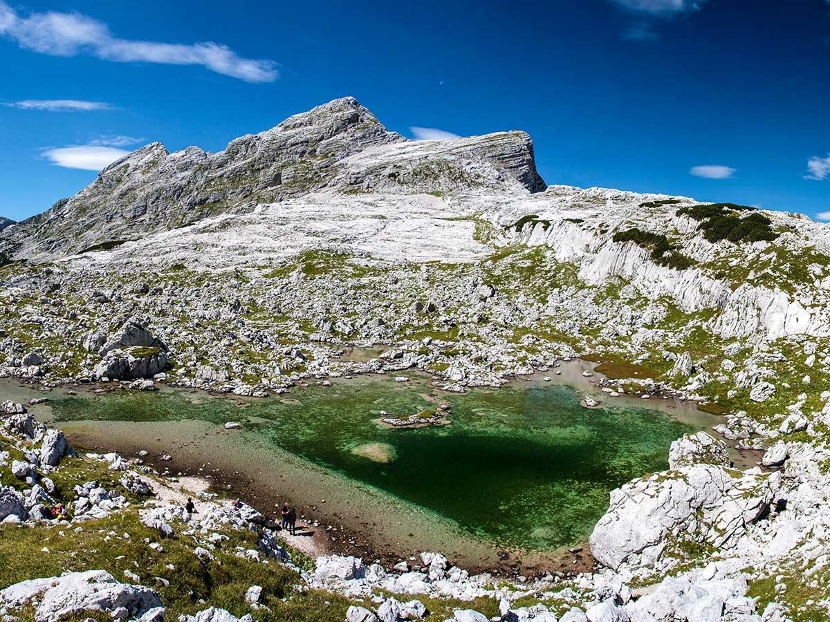Blue tarn near Kanjavec peak seen on Hiking in Slovenian Alps on Hut to Hut tour