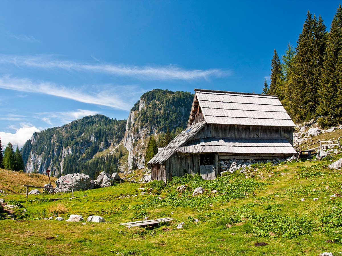 Authentic Slovenian Farmhouses seen on Hiking in Slovenian Alps on Hut to Hut trek with guide