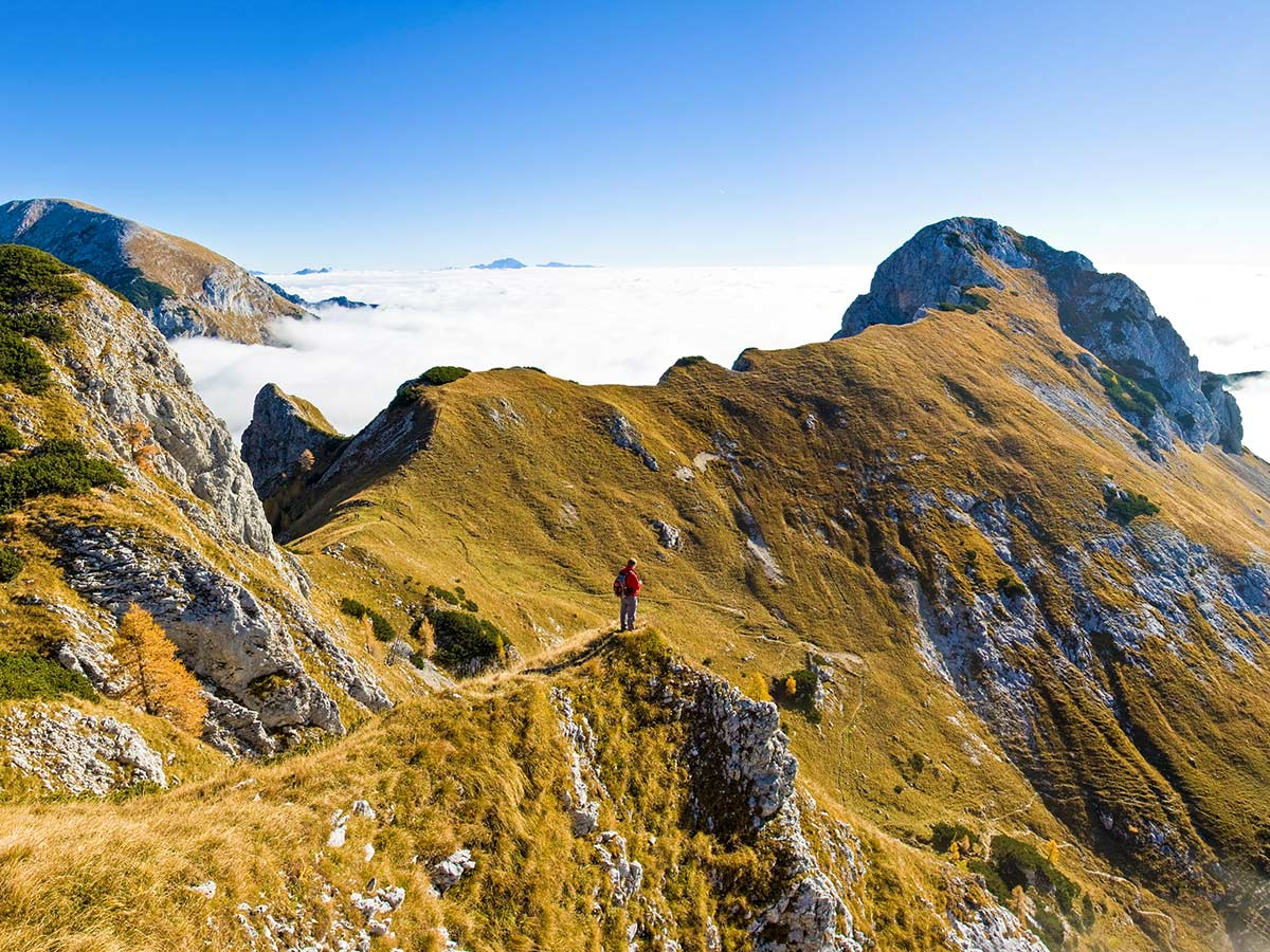 Hiking in Slovenian Alps on Hut to Hut tour includes hiking above the clowds