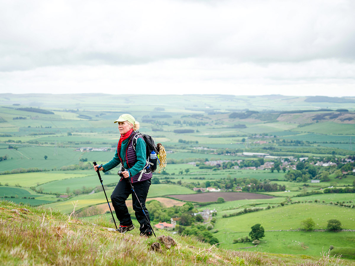Hiker posing in front of the faltlands on Northumberland and the Lake District guided walking tour