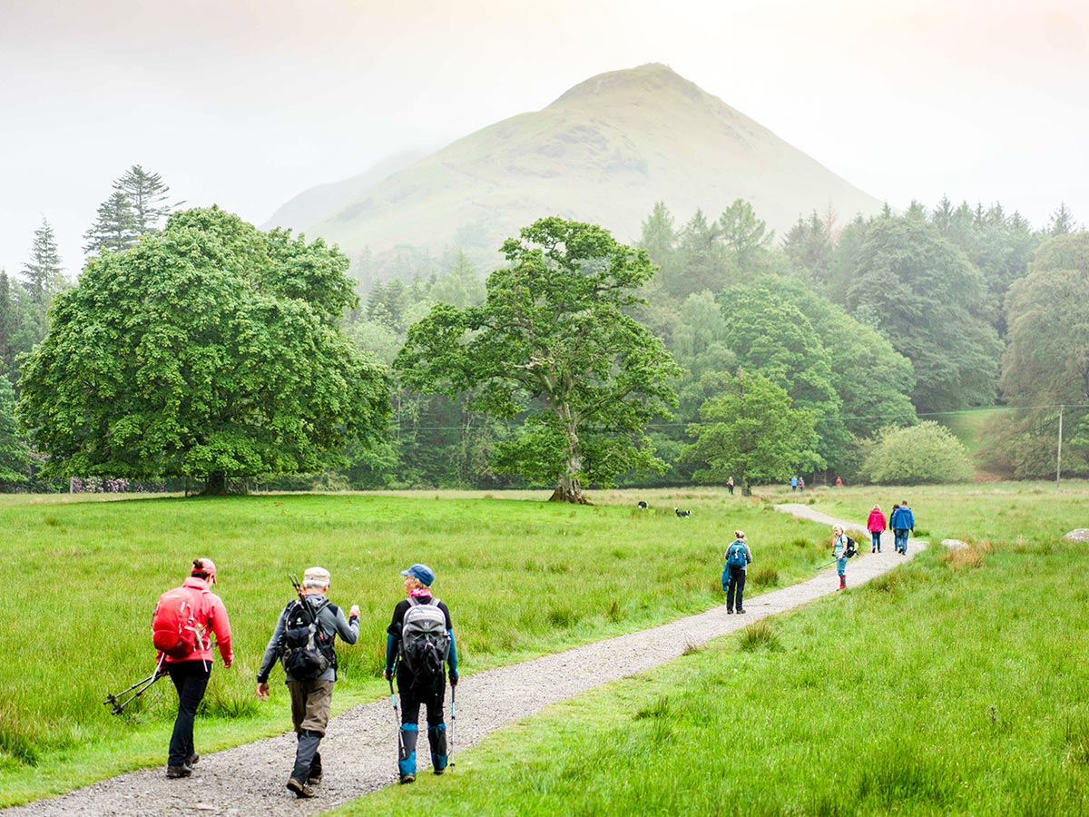 Group of hikers in front of the mountain on Northumberland and the Lake District guided walking tour
