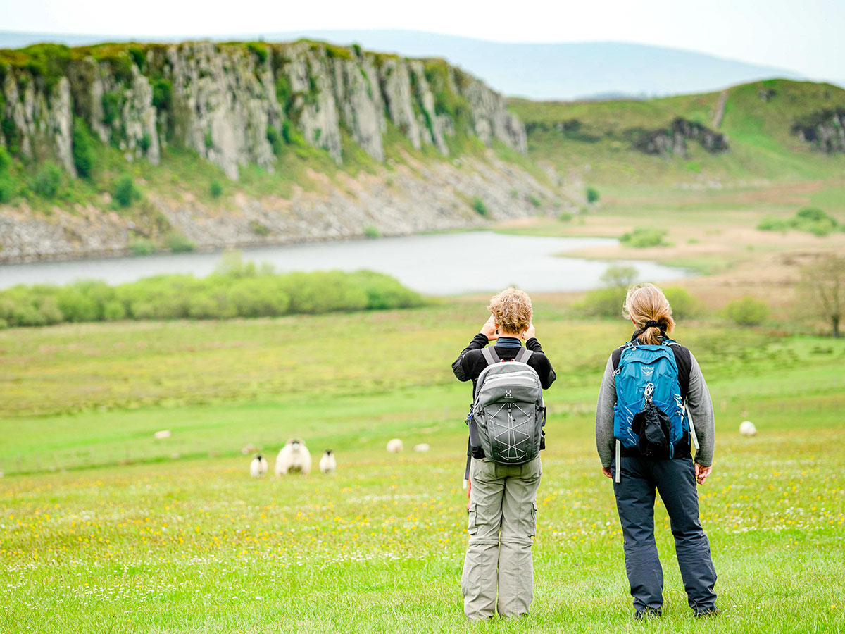 Two hikers observing the views on Northumberland and the Lake District guided walking tour