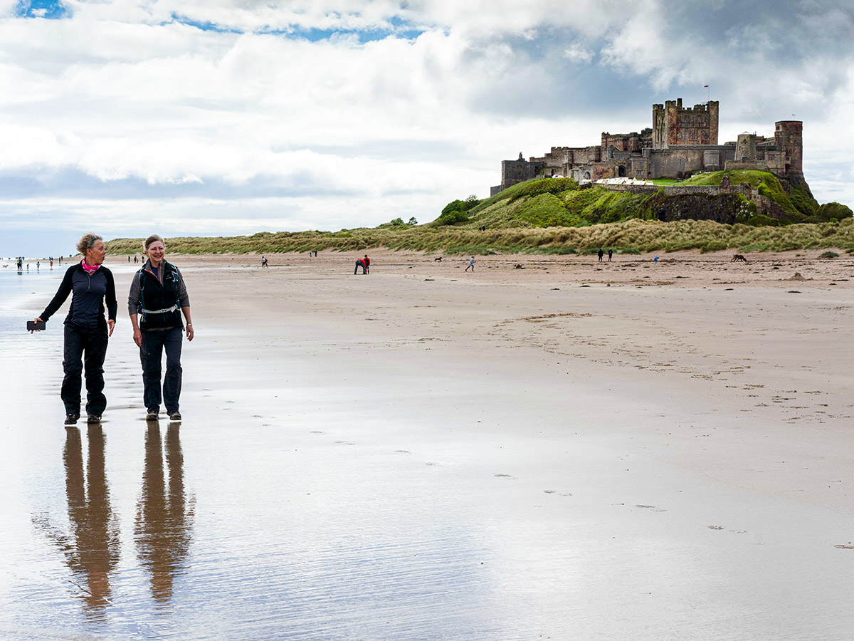 Walking along the Northumber Beach on Northumberland and the Lake District guided walking tour