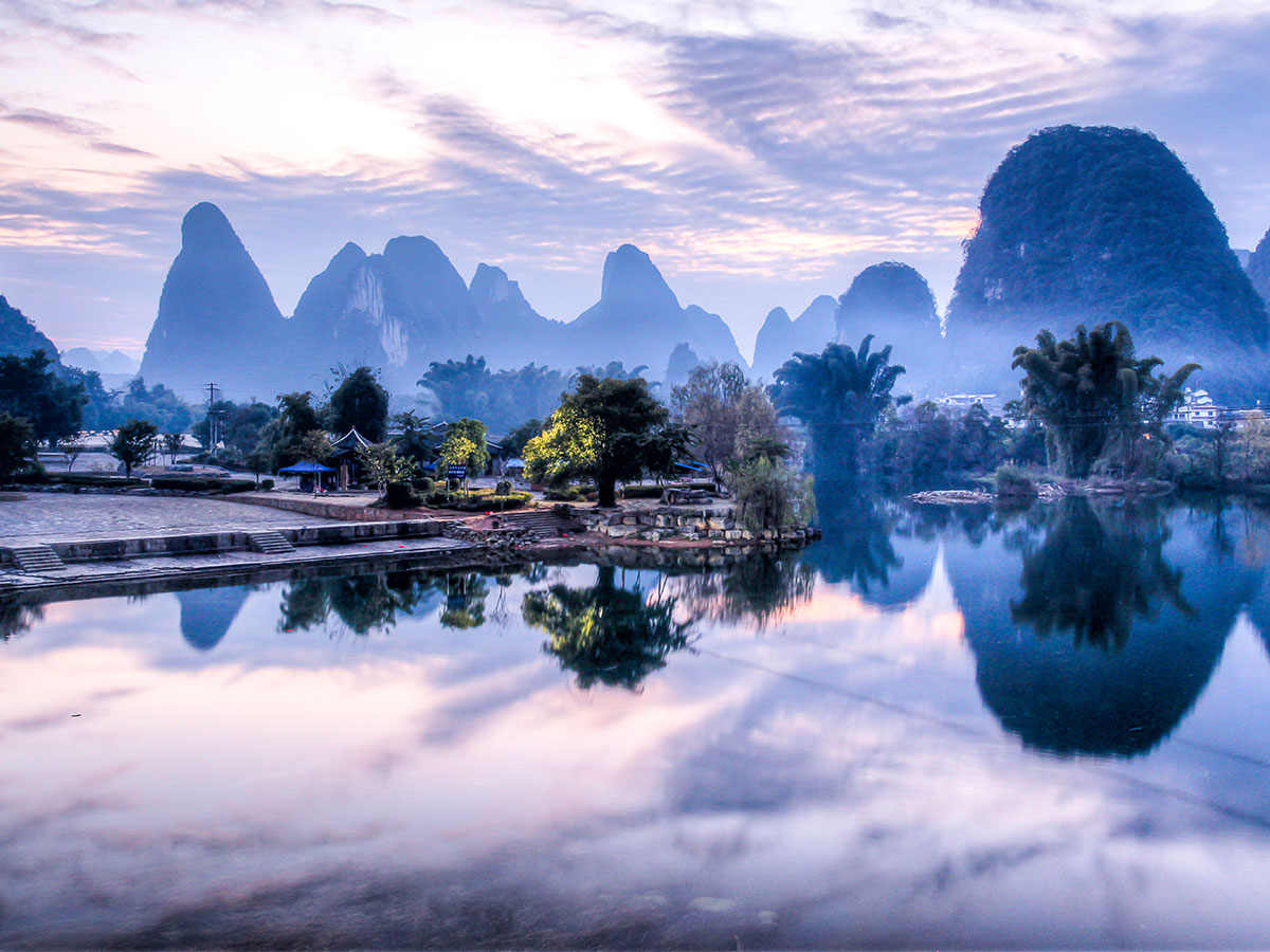 Fog over Yangshuo seen on a biking tour in China