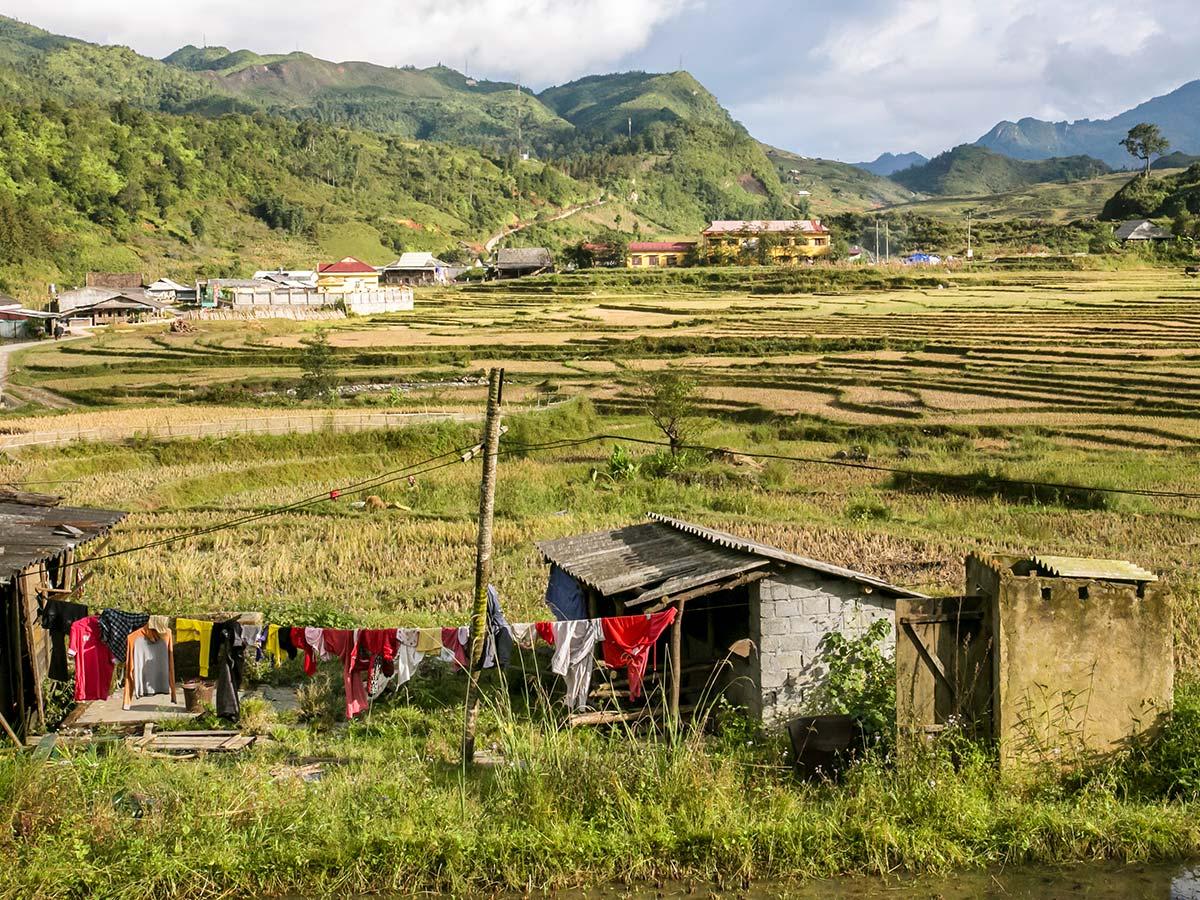 Expansive farmlands in the valleys seen on North Vietnam Mountain Trek