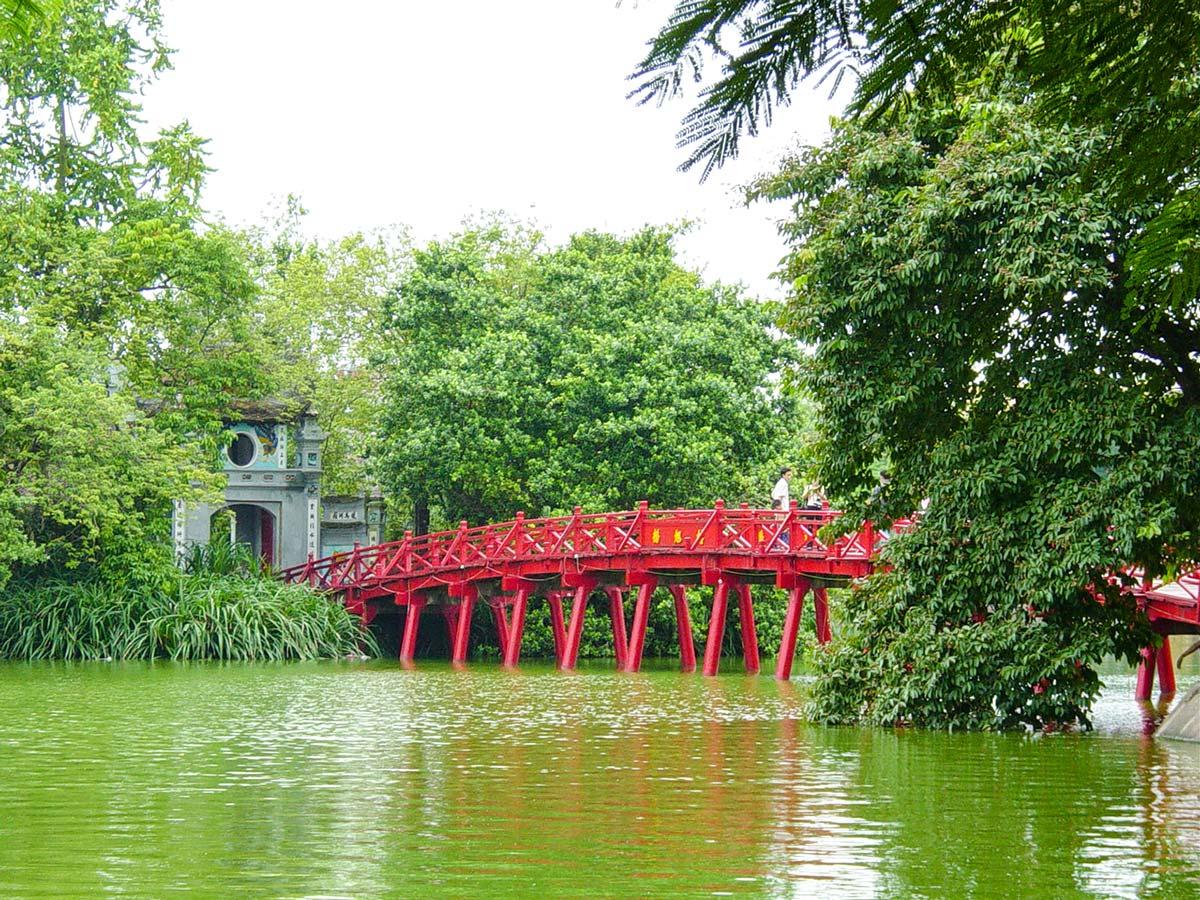 Red bridge over the river in Vietnam seen on North Vietnam Mountain Trek