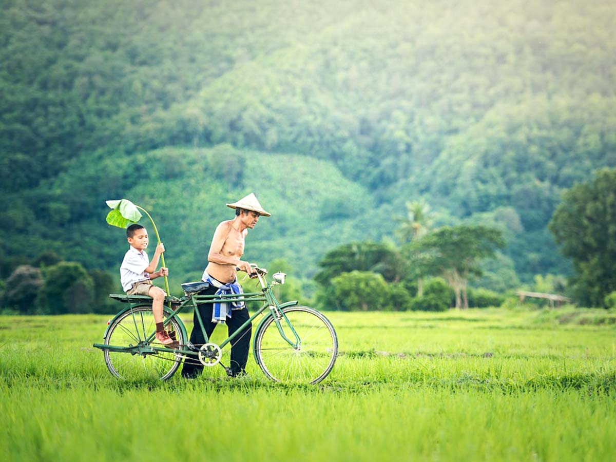 Father and son cycling seen on Northern Vietnam Mountain Biking Tour