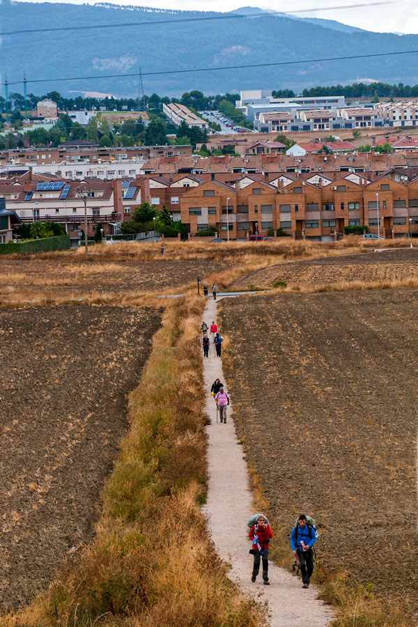 Goup of hikers departing Pamplona on Camino de Santiago French Way full trek