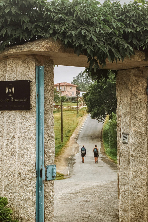 Two trekkers on a Camino de Santiago trail French Way