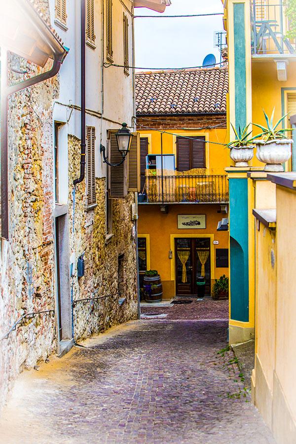 Narrow street of Alba on self guided Biking in Piedmonte Tour in Italy