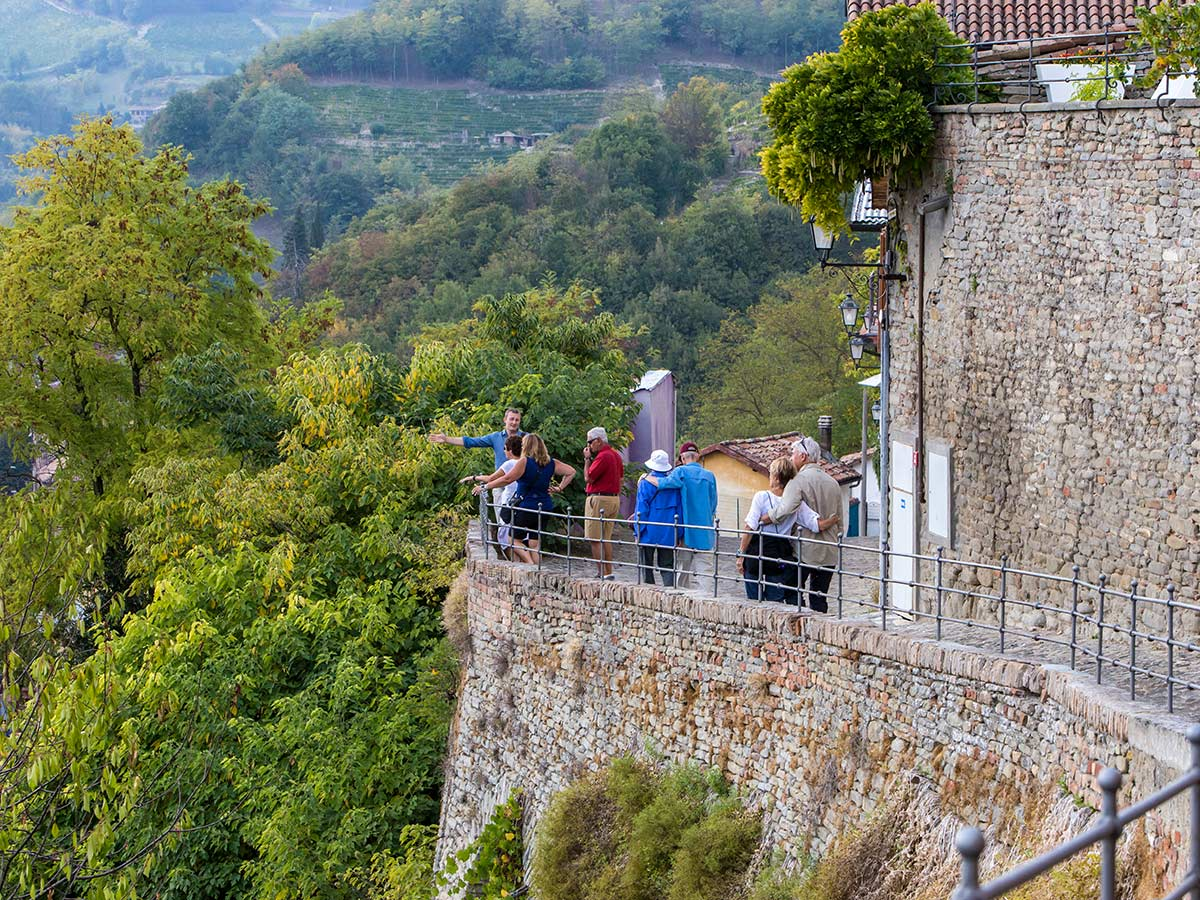 Group of travellers observing beautiful views of surrounding Piedmonte Region
