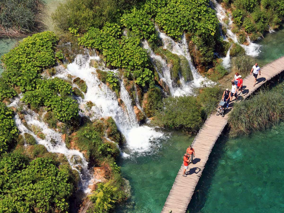 Group of travellers near Plitvice Waterfalls, on Journey Through Colors Tour in Croatia