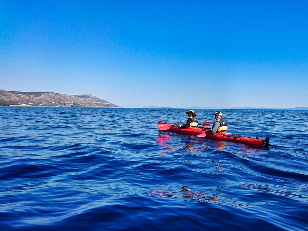 Family Adventure Tour in Croatia includes kayaking in the sea near Pakleni Islands