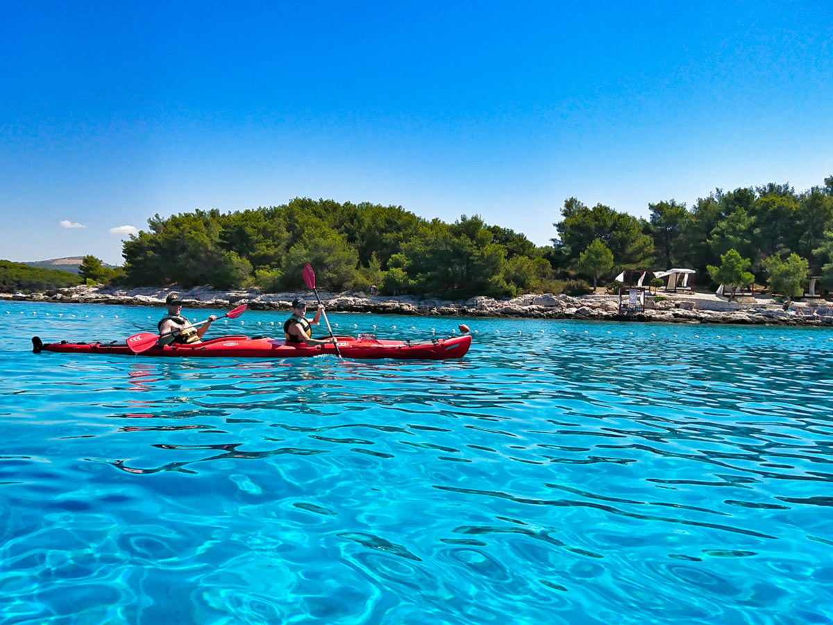 Turquose water and red kayak near Pakleni Islands Croatia