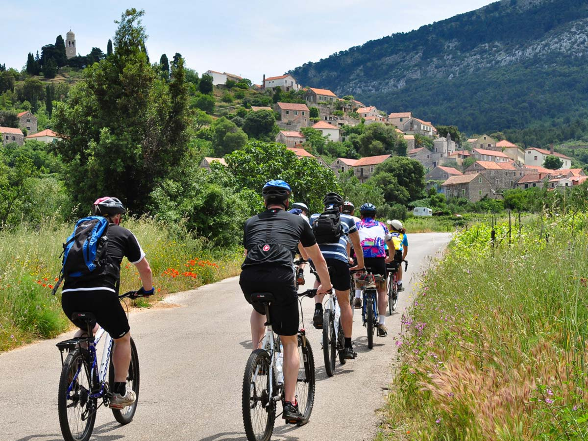 Group of bikers cycling in Hvar Island on a Family Adventure Tour in Croatia