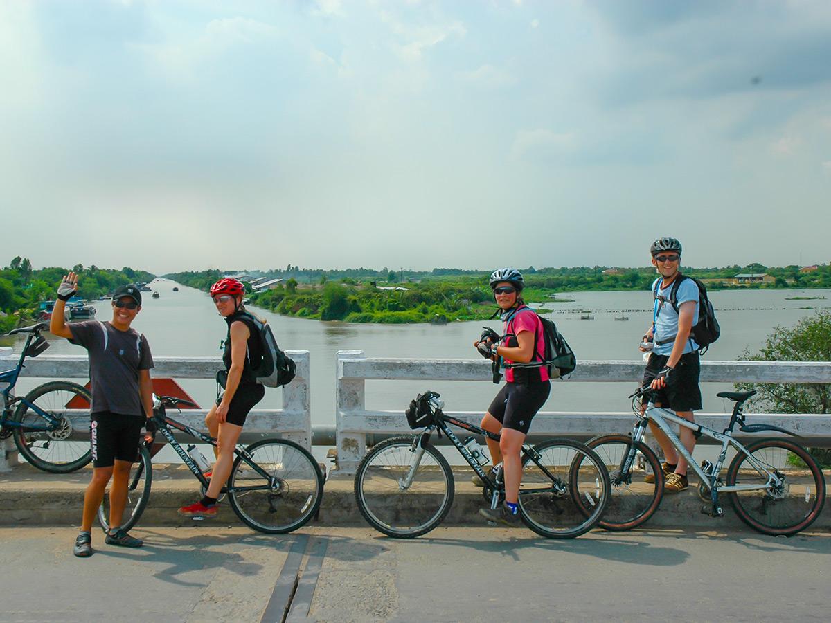Group of bikers resting on the bridge on Coast of Vietnam Tour