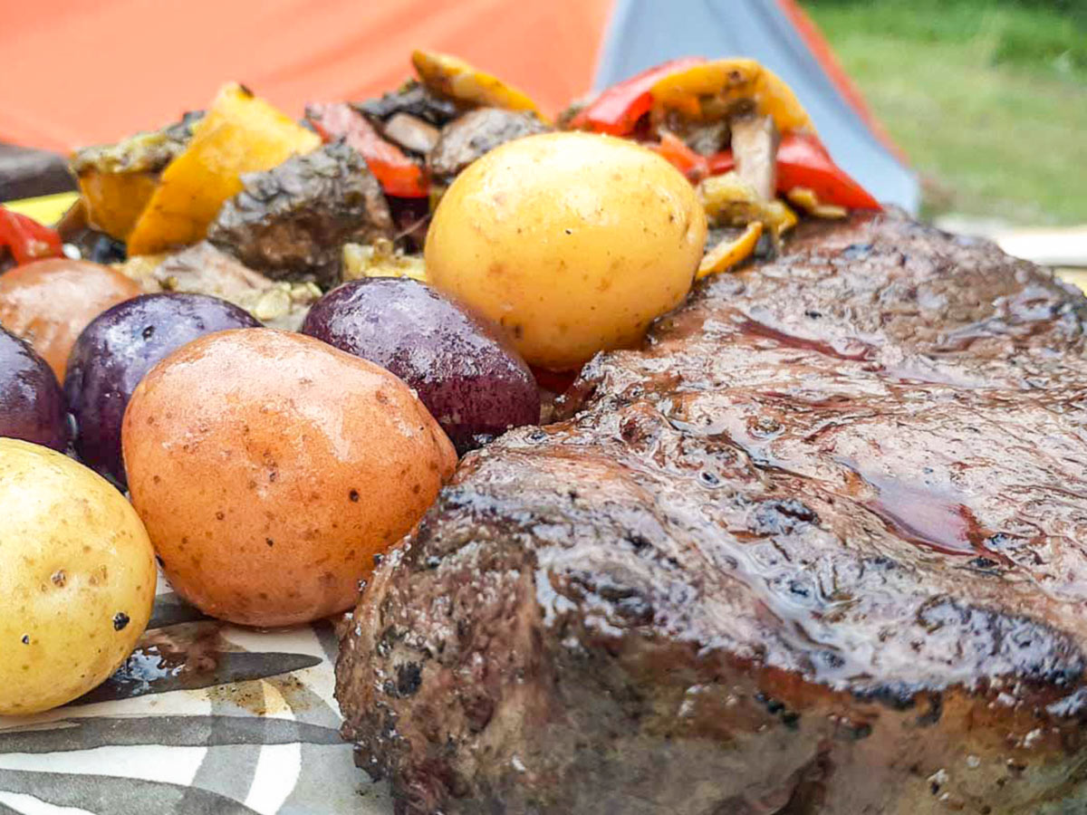 Steak dinner on a camping and hiking adventure tour in the Canadian Rocky Mountains